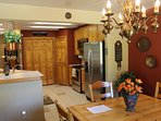 Knotty pine and stainless  kitchen and dining area.