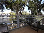 Back deck features 4 Frontgate chairs and 4 glass-top nesting tables. Perfect relaxing spot!