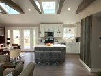 Open floor plan kitchen, living, dining areas