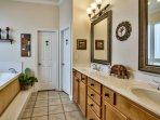1st Flr Bath w/ Jacuzzi tub, travertine shower & walk-in closet