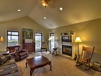 Relax in the living room with couch seating as you cozy up by the fire!