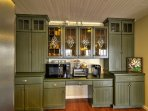 You'll love this kitchen's unique cabinetry with stain glass.