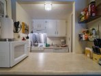 Your fully equipped kitchen with stove-top oven, dishwasher, refrigerator and microwave.