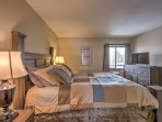 Retreat to the plush queen bed in the master bedroom.