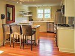 The gourmet kitchen offers granite countertops and stainless steel appliances.