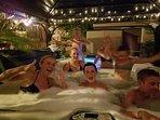 Teens enjoying hot tub at night