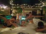 Teens having fun in hot tub at night