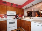 Our kitchen has full size appliances, coffee maker, blender, toaster, plenty of cook and serveware.