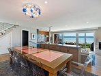 Open floor plan with huge views from kitchen, dining room and cozy sitting area.