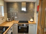 Modern fitted kitchen including washing machine & dishwasher