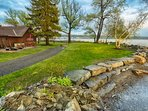 Front of house and level yard in spring; east shore of Cayuga Lake in the distance. ©2017