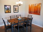 Dining table for six adjacent to the kitchen.
