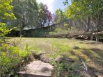 Front lawn area offers bench seating and privacy