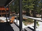 Bottom deck view May 2017. Pines! PRIVATE HOT TUB behind photographer. Snow lingers late this year!