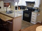 Fully equipped kitchen with breakfast, full size stove and fridge & small dishwasher