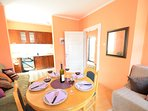 Guest Apartment Dining Room and kitchen with double sofa bed and single sofa bed.