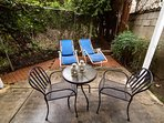 Patio with table, chairs and lounges.