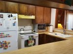 Fully stocked kitchen with all major appliances, coffee maker, hand & dish soap, paper towels