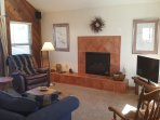 Living Room at Entry, with Gas Fireplace and Back Porch