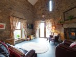 Spacious lounge with underfloor heating and stunning countryside views