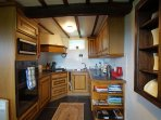 Well equipped Kitchen with Electric hob, electric oven, fridge and microwave