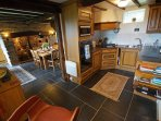 Kitchen extends to a lovely dining area with a cosy woodburner