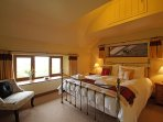 Master bedroom with a king size bed and beautiful countryside views