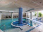 Indoor pool and jacuzzi with sauna