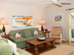 Large sofa is queen size sleeper. Linens provided with each rental.