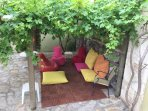 Lovely gazebo under the grape vine. Great for sitting in the shade or enjoying an evening BBQ.