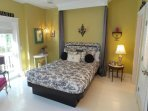 French themed second floor bedroom with private balcony facing front of house