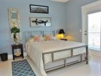 Blue bedroom, second floor with en suite bath and deck access (facing marsh)