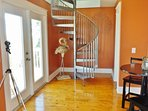 Spiral stairs leading to fourth bedroom - 'ship's watch'. Bathroom on right of staircase