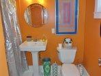 En suite bath in blue bedroom