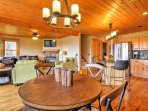 Pristine hardwood floors and ceilings create a mountain-cabin environment, while a bright, open floor plan, centered...
