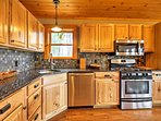 Step inside the elegant, fully equipped kitchen, with new stainless steel appliances and bar seating surrounding the...