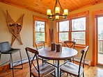 Set your food on the circular dining table that seats 4 and share memorable dining experiences while enjoying mountain...