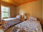 The main floor 'Back Room' features 2 twin-sized beds, perfect for younger travelers.