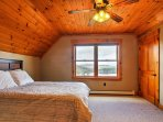 Upstairs, you'll find 2 bedrooms, split by a full bathroom, with queen-sized beds and stunning window views.