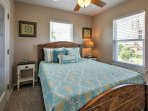 Snuggle up in this queen-sized bed for a restful evening.