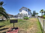 Enjoy the vast grassy lawn area and charcoal grill in the backyard.
