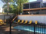 Gentle steps down to pool area. Large decks