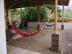 Relax like a local with your shaded hammock inside your rancho