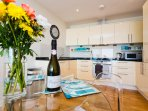 Your welcome gift includes fresh flowers, chilled Prosecco and chocolates