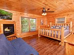 The master suite is also on the main level with a king bed, futon and fireplace