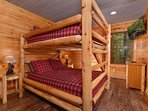 Kids and kids at heart love the queen bunk beds in a bedroom on the lower level