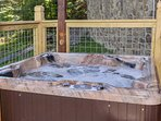 The cares seem to melt away in the hot tub.  Notice the high railings for safety.