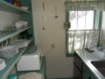 Original pantry cabinets and shelving.