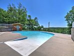 This condo is located in the Notch Estates and boasts 2 community pools!