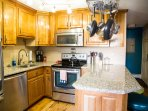 All stainless appliances, granite counters and custom hardwood cabinets